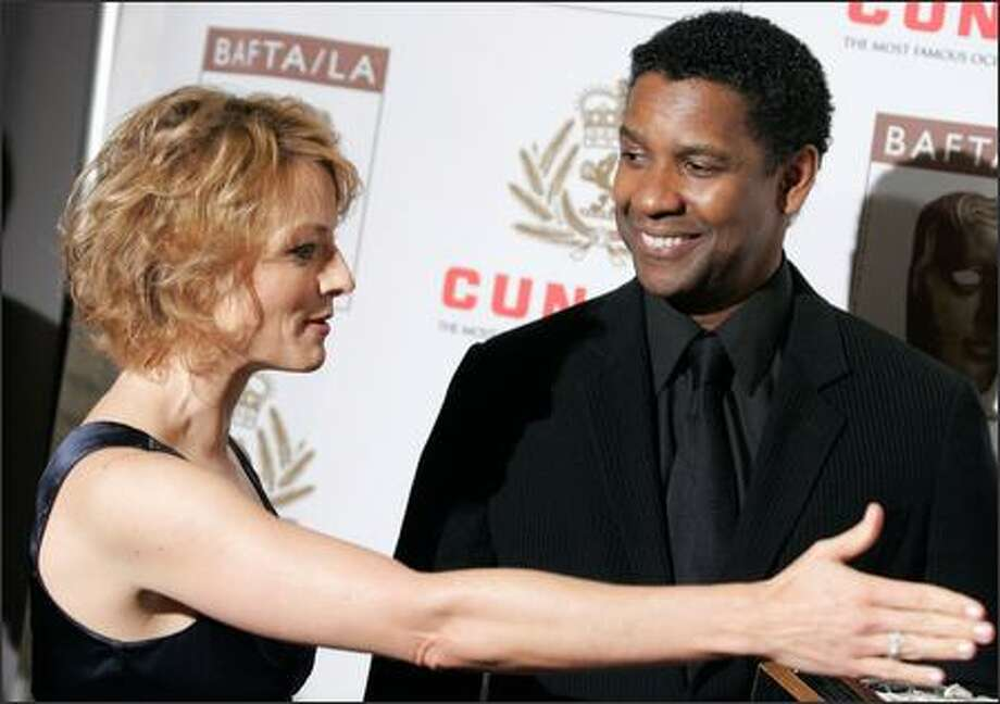 Right here, Mr. Washington, this way to your latest award. Jodie Foster probably said something to that effect Thursday when her friend Denzel Washington received the Stanley Kubrick Britannia Award for Excellence in Film at a gala in Los Angeles. The award is given by the British Academy of Film and Television Arts/Los Angeles. Photo: Associated Press / Associated Press