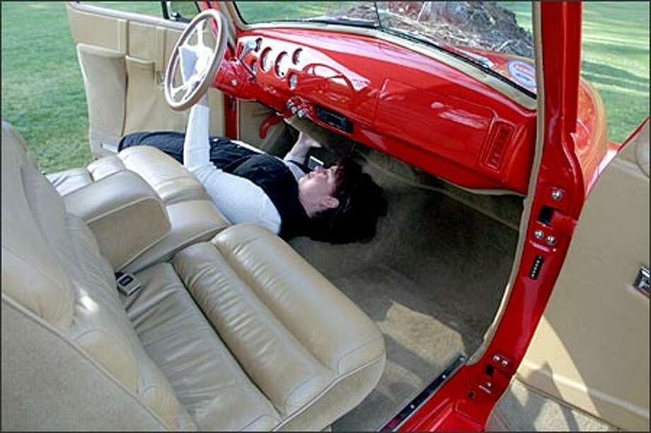 Teresa Jones of Marysville, co-owner of this $200,000 1948 Chevrolet pickup, works on the dashboard, preparing the vehicle for the Seattle International Auto Show, which opens tomorrow at the Stadium Exhibition Center. Photo: Phil H. Webber, Seattle Post-Intelligencer / Seattle Post-Intelligencer