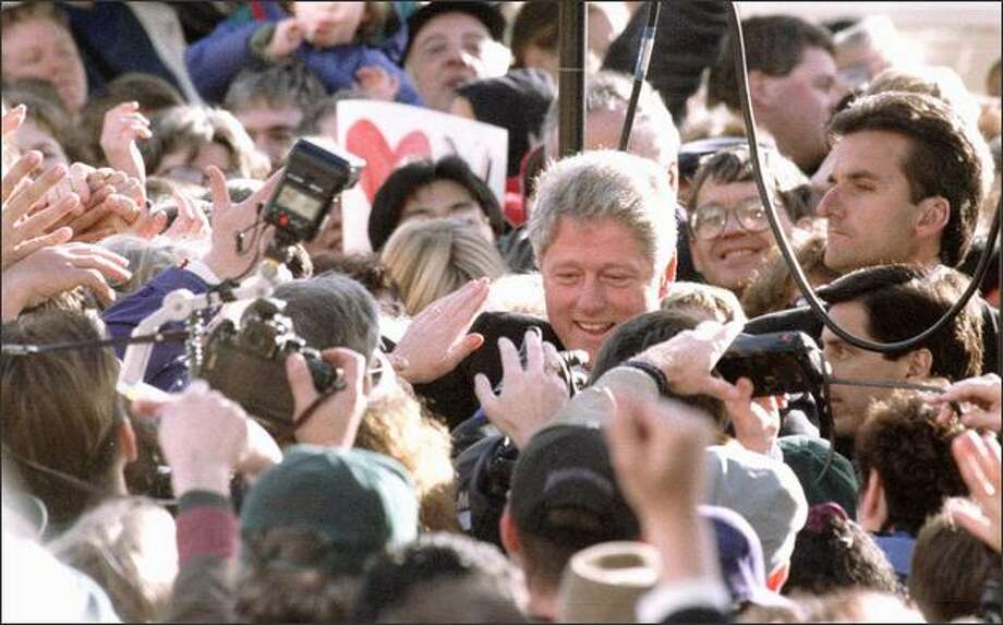 President Bill Clinton wades into the crowd at Seattle's Pike Place Park on Sunday, Nov. 6, 1994. Photo: Grant M. Haller, Seattle Post-Intelligencer / Seattle Post-Intelligencer