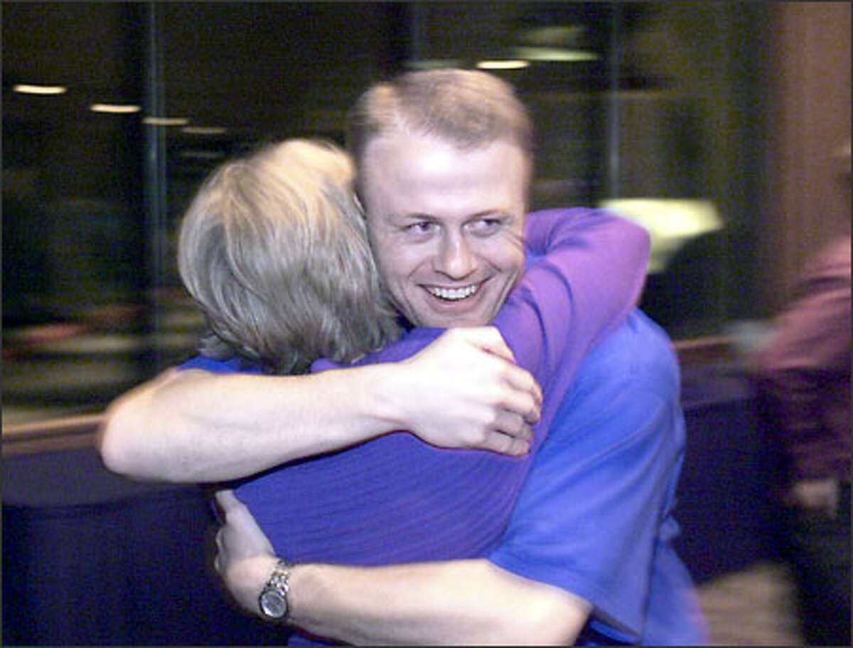 A younger Tim Eyman gets a hug from a supporter as his 1999 car-tab initiative surges toward victory.