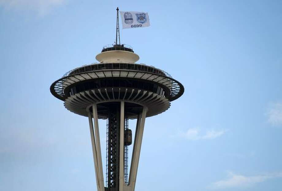 A special flag on top of the Space Needle honors slain Seattle Police Officer Tim Brenton. Photo: Thom Weinstein, Seattlepi.com / seattlepi.com