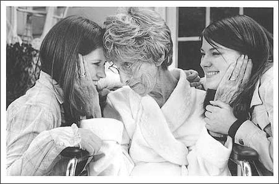 """Laurel, a wife, mother and grandmother relished the time she spent with her close-knit family. These photos were taken after she had been in hospice care for more than six months. Seattle photographer Nancy Medwell, who used to be a hospice volunteer, saw """"a beautiful evolution of life."""" Photo: Nancy Medwell"""