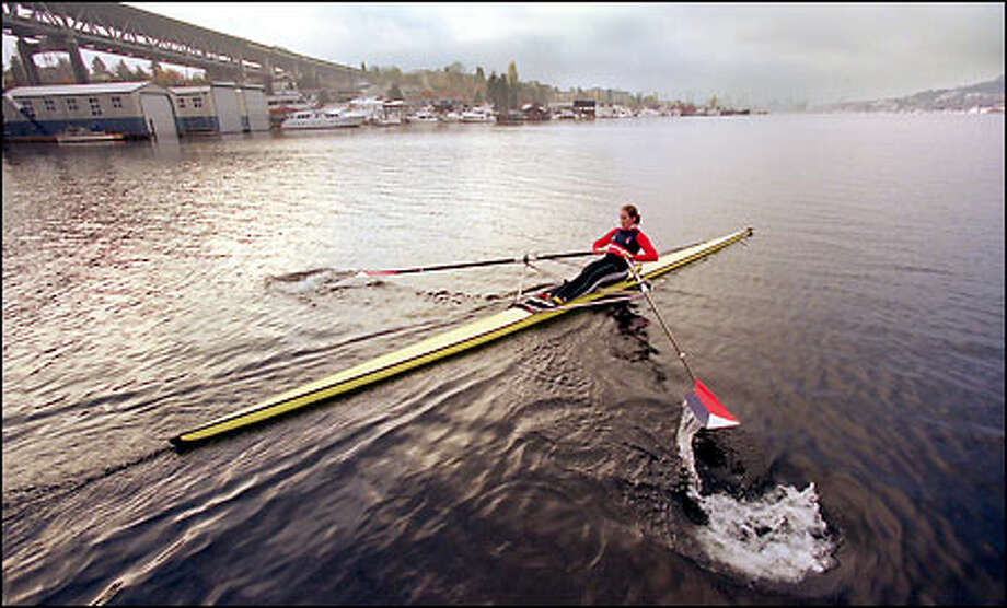Laura Rauchfuss sculls on Lake Union during a morning practice. Rauchfuss moved here last year from Georgia to train with the elite squad at the Pocock Rowing Center. In June, she won a bronze medal in double sculling at the Rowing World Cup held in Spain. Photo: Meryl Schenker, Seattle Post-Intelligencer / Seattle Post-Intelligencer