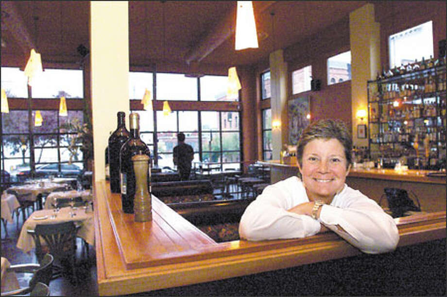 Christine Keff, owner of Flying Fish, has kept her Belltown restaurant afloat with engaging and the freshest of fresh seafood prepared in cutting-edge Pacific Rim styles. Photo: Loren Callahan, Seattle Post-Intelligencer / Seattle Post-Intelligencer