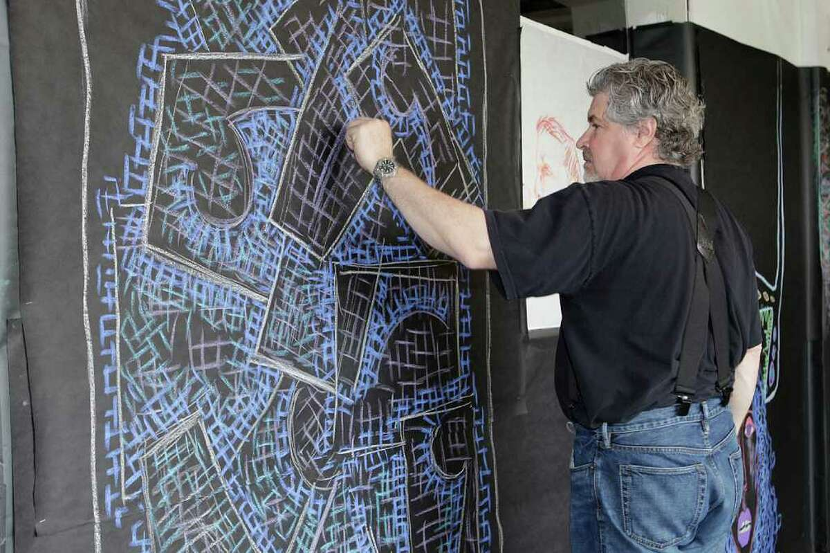 Paul Larson, one of the artists of the Loft Artists Association, works on his mural at last year's Draw On event. The free community drawing festival returns Saturday, April 9, from 2 to 5 p.m., at the association's gallery space at 845 Canal St., Stamford.