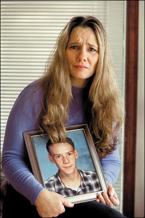 Lisa Rakestraw is comforted by memories of her son, Dustin, who, she said, was so generous he'd give his clothes away without blinking and offer his room if another kid needed a place to crash. Photo: Gilbert W. Arias, Seattle Post-Intelligencer / Seattle Post-Intelligencer