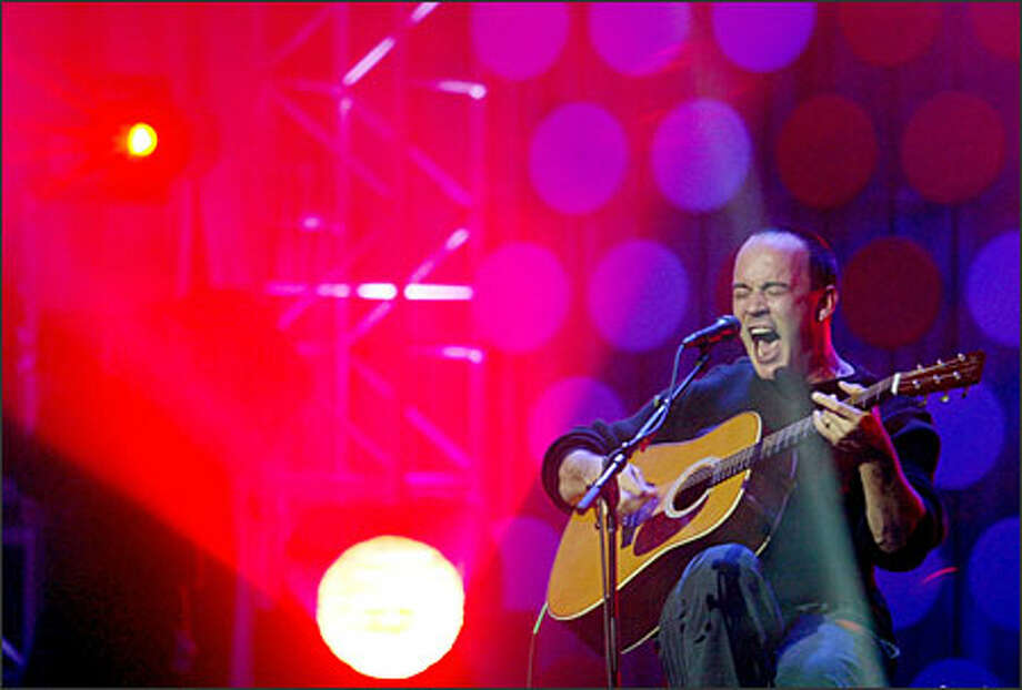 "Though saying ""all the cameras make me nervous,"" Dave Matthews enthralled the audience with his powerful ""Crash Into Me,"" ""Crush"" and ""Everywhere."" Photo: Dan DeLong, Seattle Post-Intelligencer / Seattle Post-Intelligencer"