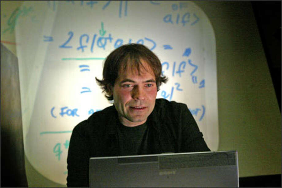 UW professor Andreas Karch, here teaching a class in quantum mechanics, is co-author of a paper on string theory in an American Physical Society journal. Photo: Grant M. Haller, Seattle Post-Intelligencer / Seattle Post-Intelligencer