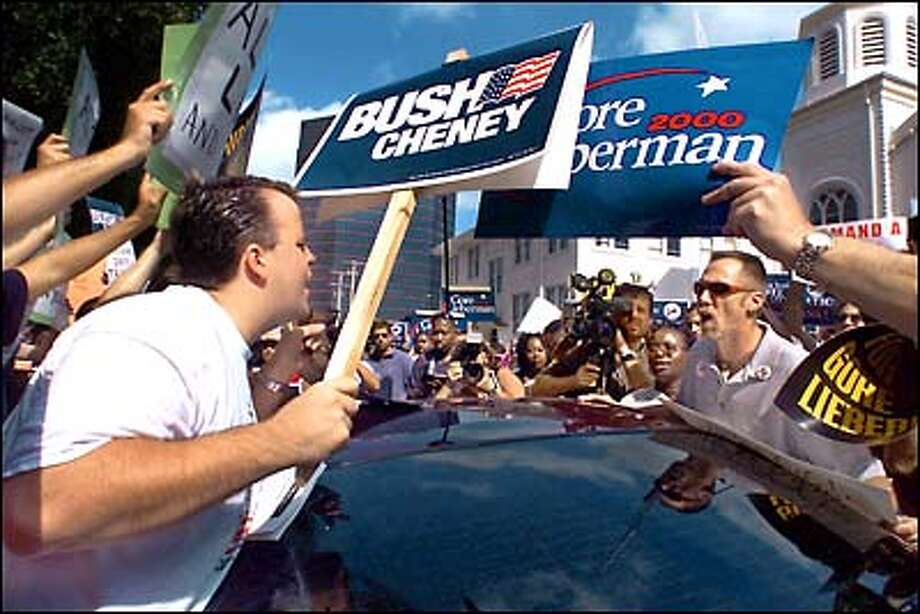 Supporters of George W. Bush and Al Gore clash outside the county building in West Palm Beach, as tensions escalated yesterday over the unresolved Florida vote for president. Both campaign organizations sent dozens of lawyers and political operatives to Florida and geared up fund-raising drives to finance what is exploding into a political donnybrook. Photo: Associated Press / Associated Press