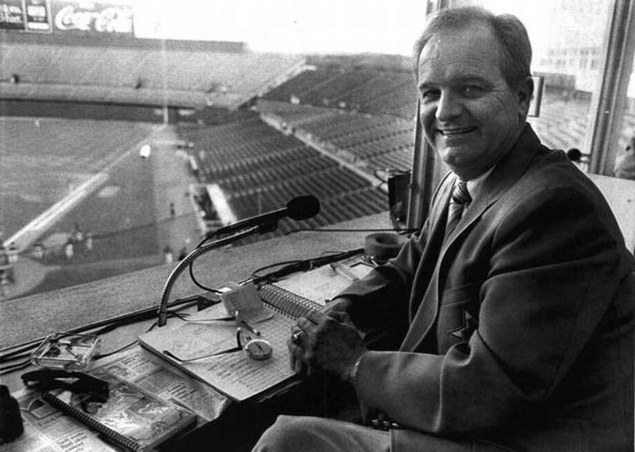 Mariners announcer Dave Niehaus behind the mic in 1985. (seattlepi.com file)