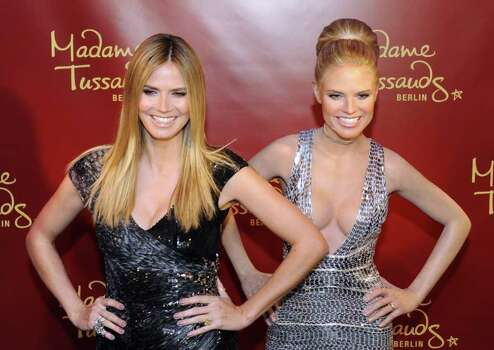 German top model Heidi Klum (L) smiles as she poses with a wax likeness of herself during an unveiling ceremony at Berlin's Madame Tussaud wax museum on January 25, 2010.  AFP PHOTO / JOHN MACDOUGALL Photo: JOHN MACDOUGALL, AFP/Getty Images / 2010 AFP
