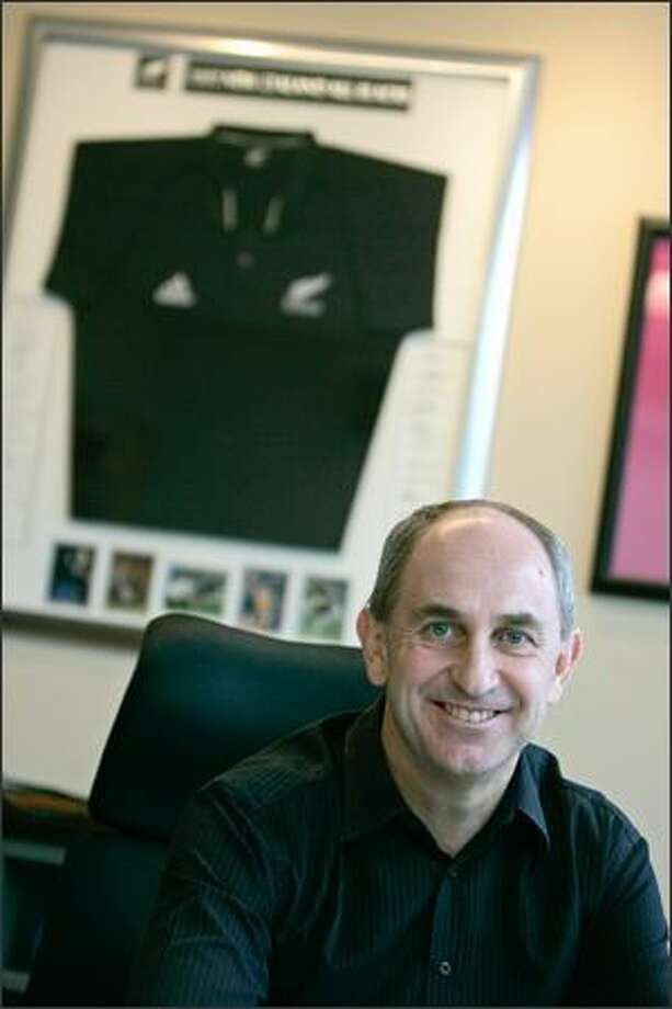 Microsoft finance chief Chris Liddell, a New Zealand native, displays a New Zealand All Blacks rugby jersey in his office. Photo: Mike Kane, Seattle Post-Intelligencer / Seattle Post-Intelligencer