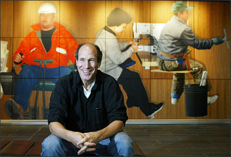 "It took Michael Fajans five years to take his ambitious project from idea to installation. His mural, titled ""Three Sets of Twelve,"" spans three floors on the back wall of the lobby of the new federal courthouse downtown. Photo: Meryl Schenker, Seattle Post-Intelligencer / Seattle Post-Intelligencer"