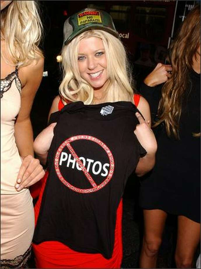 Here's Tara Reid, showing off a Paparazzi Chic T-shirt at her 30th birthday party. Poor thing thinks the paparazzi are the enemy. Tara, honey, your enemies are the following: Yourself, your stylist (anyone who allows you to be photographed in a trucker hat in 2005 should be fired) and your agent, for obvious reasons. Photo: Associated Press / Associated Press