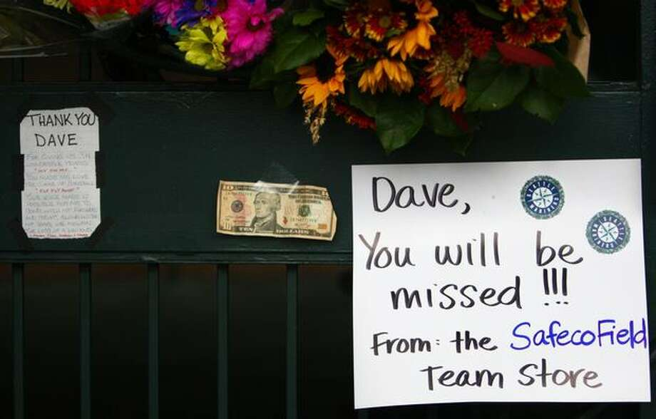 A $10 bill was among the items left at a growing memorial to longtime Mariner broadcaster Dave Niehaus at the gates of Safeco Filed on Thursday, November 11, 2010. Niehaus died of a heart attack on Wednesday. Photo: Joshua Trujillo, Seattlepi.com / seattlepi.com