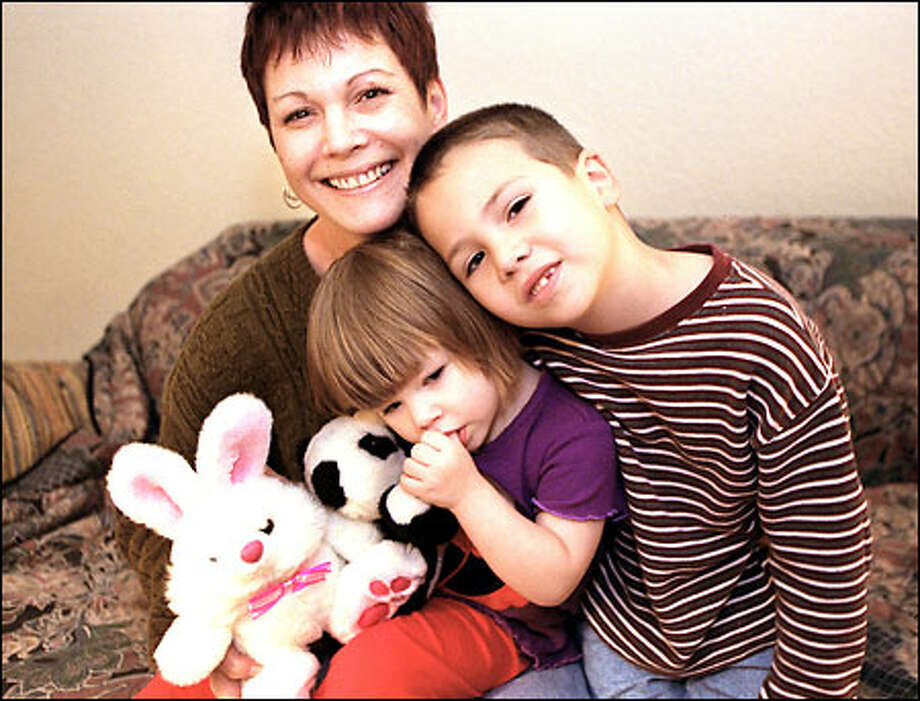 Donna Beavers of Seattle poses with daughter Natalie, 2, and son Sam, 5. Beavers has been helped by the Solid Ground for Families program. Photo: Renee C. Byer, Seattle Post-Intelligencer / Seattle Post-Intelligencer