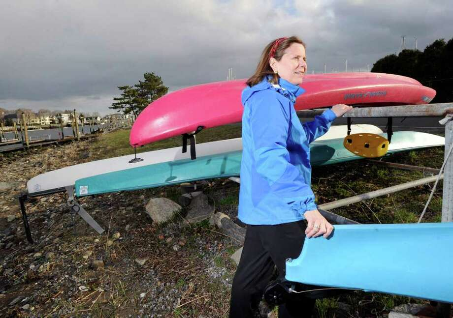 Betsy Kreuter of Old Greenwich at the Grass Island boat rack Tuesday afternoon, April 5, 2011.  Kreuter is upset that many of the kayaks and canoes stored in boat racks on town property have expired permits or no permits at all. Photo: Bob Luckey / Greenwich Time