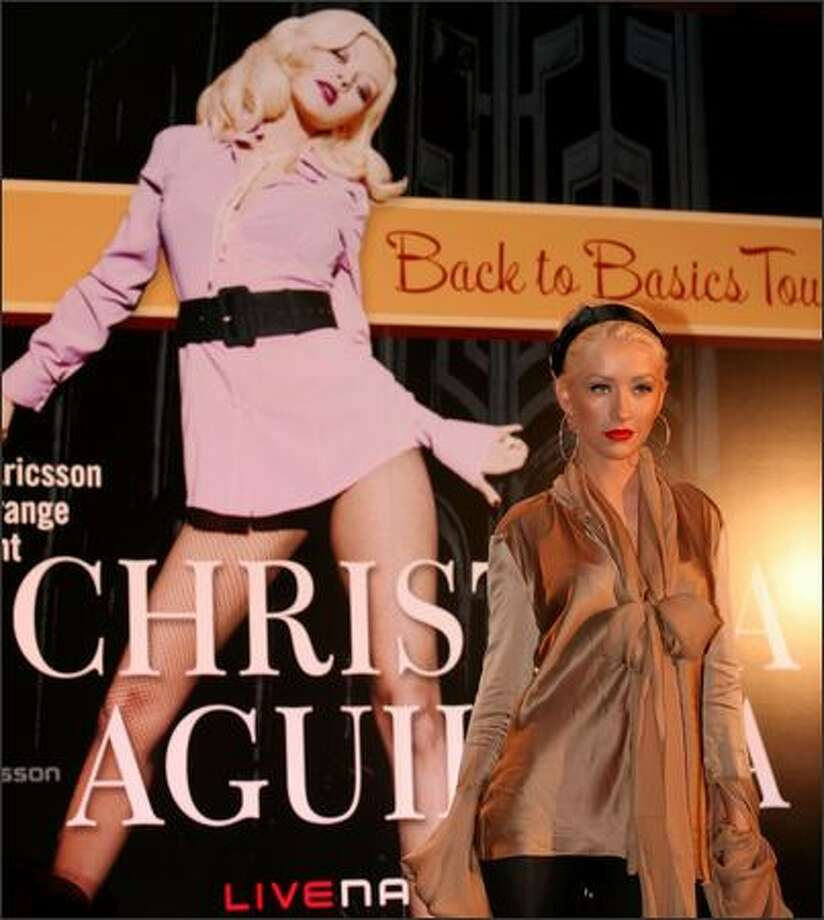 "Christina Aguilera is calling her new world tour ""Back to Basics."" Apparently that means eschewing pants or skirts, judging from the poster at Aguilera's kickoff event Wednesday in London. The 18-date European leg begins Friday in Sheffield, in northern England. Photo: Associated Press / Associated Press"