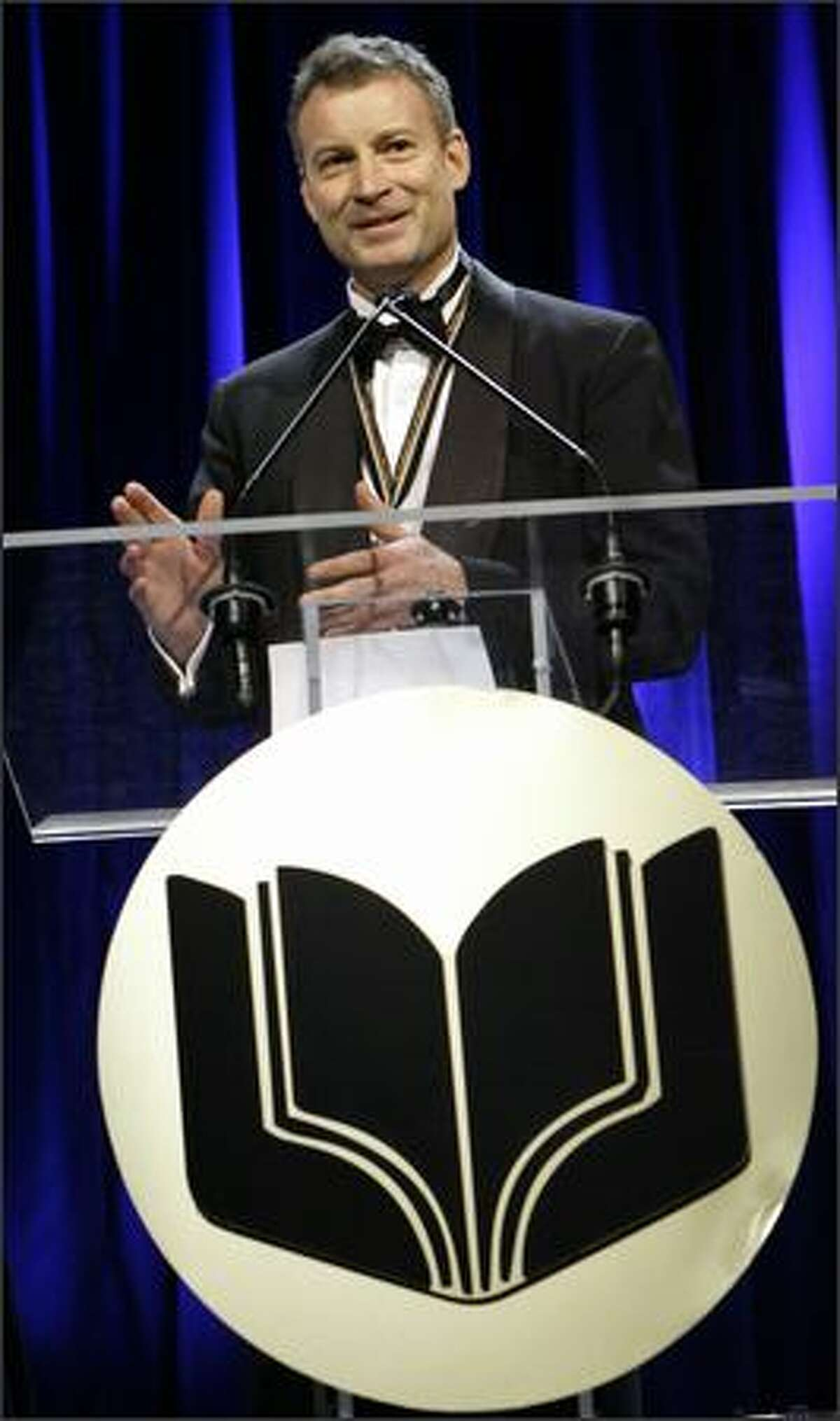 Timothy Egan addresses dinner guests after accepting the award for best nonfiction at the 2006 National Book Awards in New York. (AP Photo/Stuart Ramson)