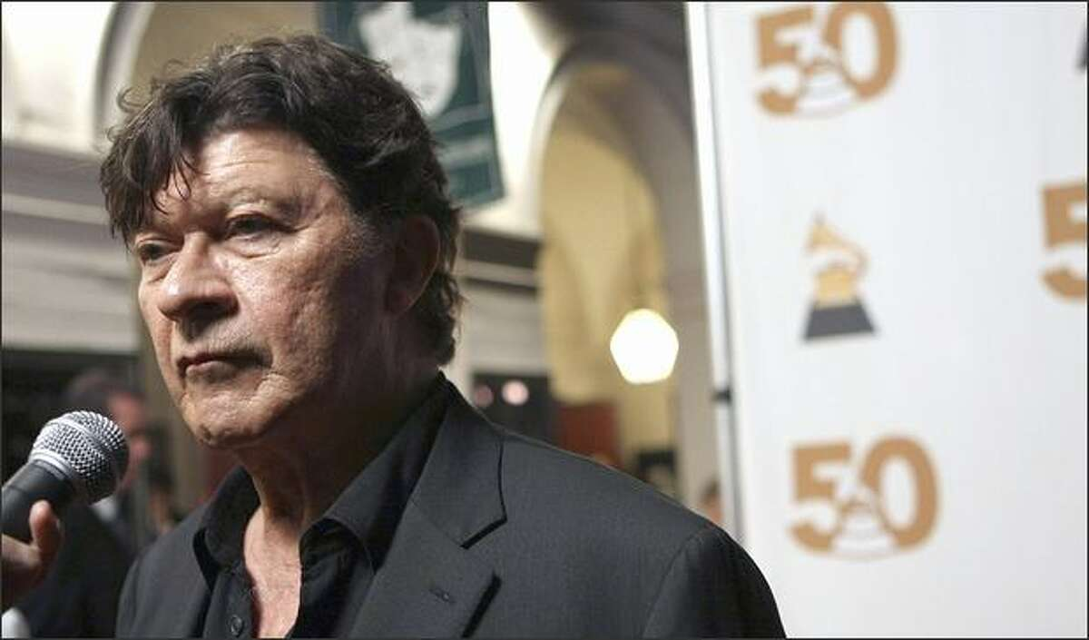 Singer Robbie Robertson arrives at The Recording Academy's Special Merit Awards ceremony on Feb. 9, 2008, in Los Angeles.