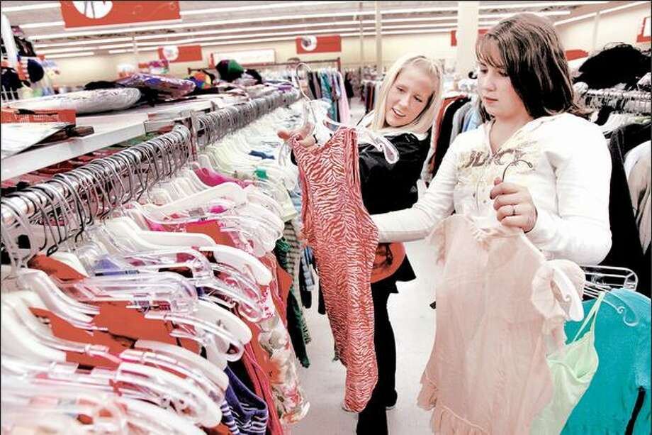 Ballard High School seniors Katherine Landerholm, 17, left, and Brittani Potter, 17, check out clothes at the Crown Hill Value Village. Photo: Grant M. Haller, Seattle Post-Intelligencer / Seattle Post-Intelligencer