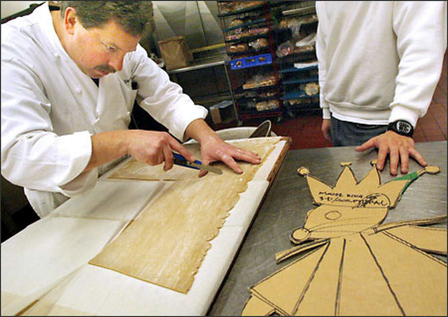 David Mestl, executive sous chef at the Sheraton Seattle Hotel & Towers, pulls up the dough for the Mouse King's crown. Photo: Renee C. Byer, Seattle Post-Intelligencer / Seattle Post-Intelligencer