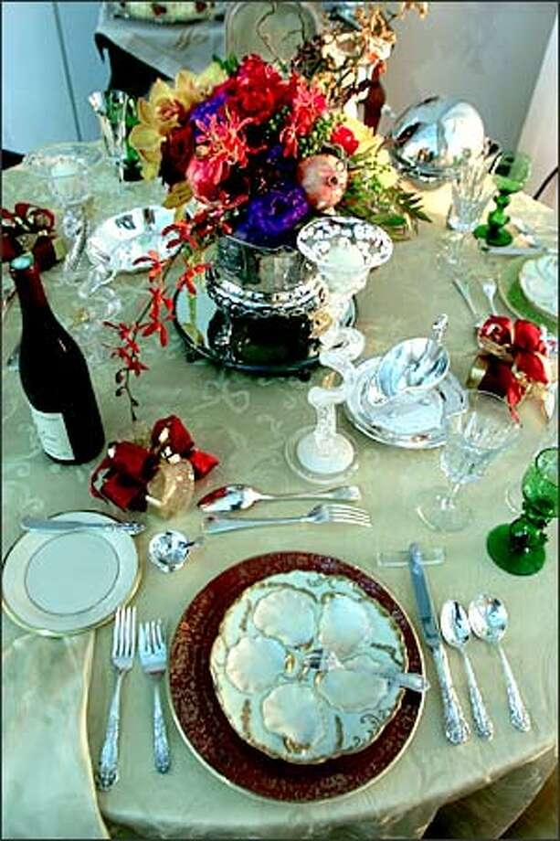 "Interior designer Myrna Morey created this ""Grand Occasion"" table setting for the recent Interior Design Show in Seattle. Morey used antique oyster plates, an Italian linen tablecloth and a silver-plated egg-server centerpiece. Photo: Scott Eklund, Seattle Post-Intelligencer / Seattle Post-Intelligencer"