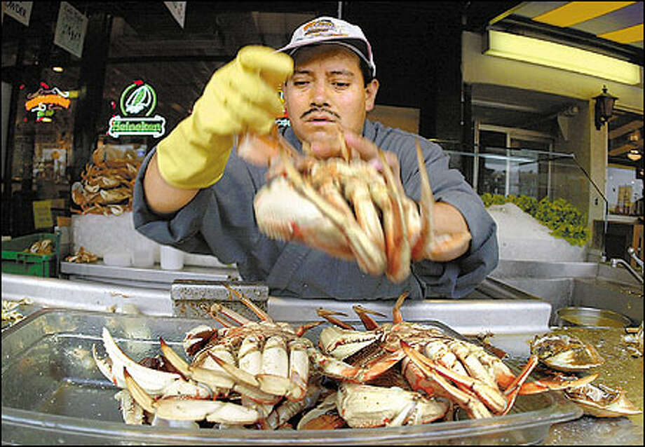 Domingo Chavez prepares Dungeness crabs from Washington state at Alioto's Restaurant on Fisherman's Wharf in San Francisco. Photo: Associated Press / Associated Press