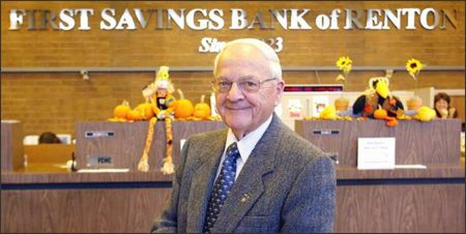 "H.A. ""Harry"" Blencoe has been head of First Savings Bank of Renton for 44 years. ""I had many offers to merge the bank or sell the bank,"" he said. ""We turned them all down."" Photo: Phil H. Webber, Seattle Post-Intelligencer / Seattle Post-Intelligencer"