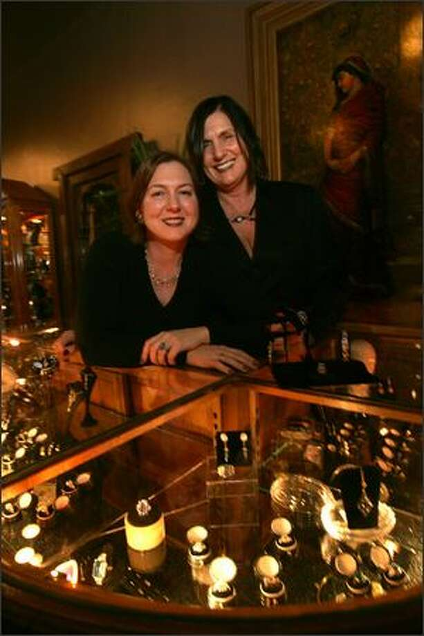 Isadora's owner Laura Dalesandro, right, and daughter Elizabeth Schoenleber pose behind the main jewelry counter at their downtown boutique. Photo: Mike Kane, Seattle Post-Intelligencer / Seattle Post-Intelligencer