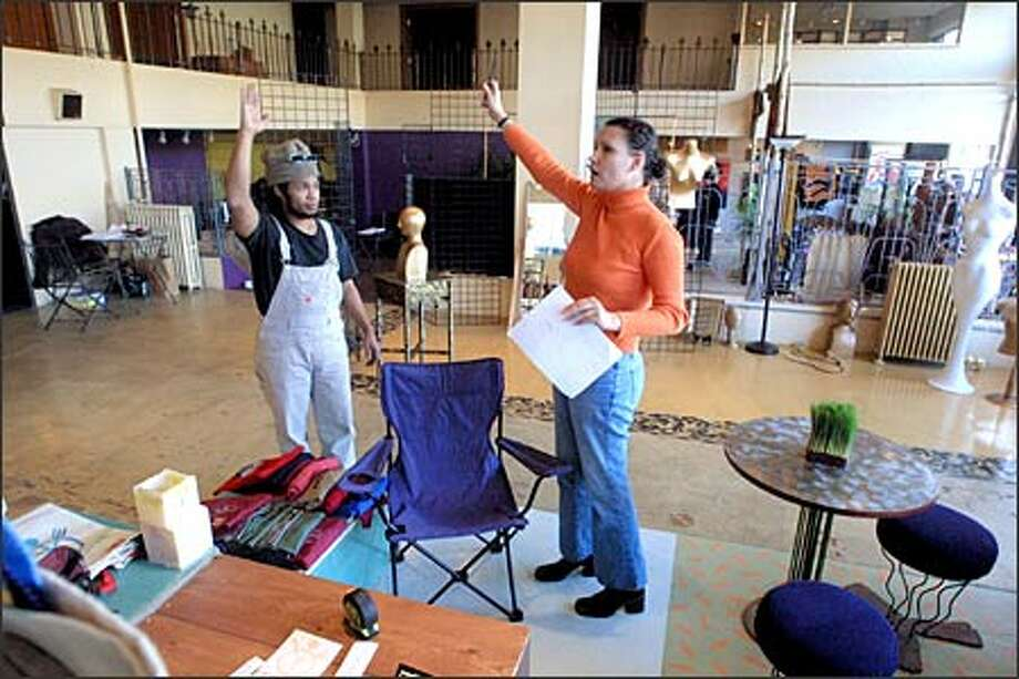 Melissa Roberts, co-owner of Seattle Independent Mall at 517 E. Pike St., helps Tony Boyd design the sales area for his Peacemeal designs at the shopping center. Photo: Phil H. Webber, Seattle Post-Intelligencer / Seattle Post-Intelligencer