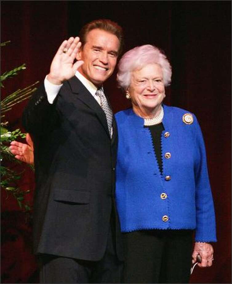 Former first lady Barbara Bush hugs California Gov. Arnold Schwarzenegger after he was presented the 2004 George Bush Award for Excellence in Public Service on the campus of Texas A&M University in College Station, Texas. Schwarzenegger joins former Soviet leader Mikhail Gorbachev, former German Chancellor Helmut Kohl and Sen. Edward Kennedy, D-Mass., as Bush Award recipients. (AP Photo/David J. Phillip) Photo: Associated Press / Associated Press
