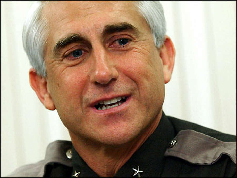 "King County Sheriff Dave Reichert fields questions about the arrest in the Green River murder case. ""I've always thought this case would be solved,"" he said. Photo: Jeff Larsen, Seattle Post-Intelligencer / Seattle Post-Intelligencer"