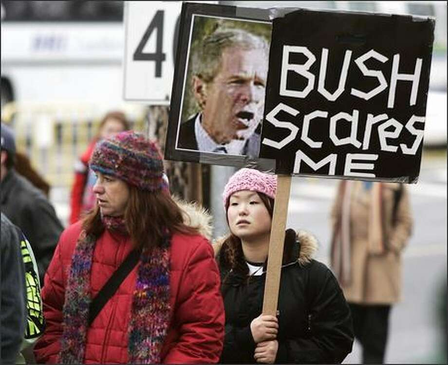 Demonstrators walk from an anti-Bush protest in downtown Halifax, Nova Scotia, Canada. U.S. President Bush was on a two-hour visit in Halifax to thank people for their help during the September 11, 2001 terrorists attacks. (AP Photo/CP, Jacques Boissinot) Photo: Associated Press / Associated Press