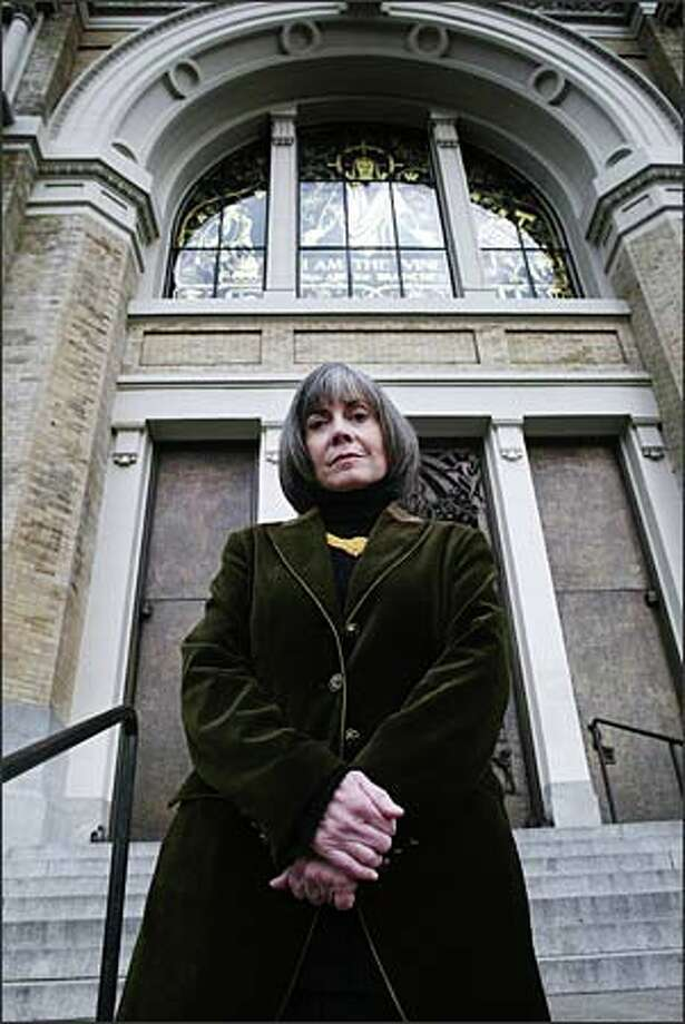 "Anne Rice, pictured on the steps of Seattle's St. James Cathedral, found fame and fortune with her vampire novels. Now she has turned her back on the hellish to embrace the heavenly with her new novel, ""Christ the Lord: Out of Egypt."" Photo: Gilbert W. Arias, Seattle Post-Intelligencer / Seattle Post-Intelligencer"