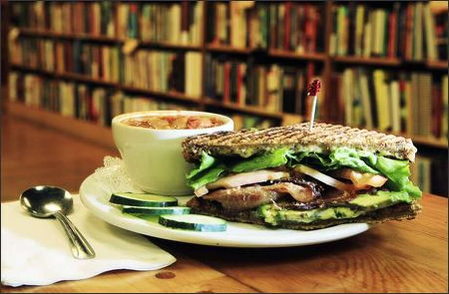 Half of a BLTA -- the 'A' stands for avocado and basil mayo -- and a cup of Senegalese Peanut With Chicken Soup costs $7. Photo: Dan DeLong, Seattle Post-Intelligencer / Seattle Post-Intelligencer