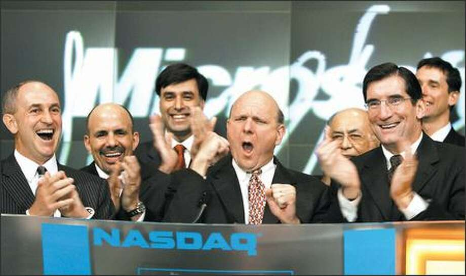 Microsoft CEO Steve Ballmer's busy day launching the new Windows Vista and 2007 Office System included ringing the Nasdaq opening bell to begin trading along with Microsoft CFO Chris Liddell, left, and Nasdaq CEO Robert Greifeld, right. Photo: Associated Press / Associated Press