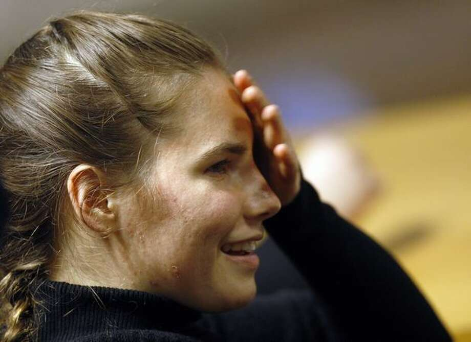 "Murder suspect Amanda Knox reacts during a hearing in a courthouse in Perugia, Italy. A defense lawyer for Knox, accused in the 2007 slaying of her British roommate in Italy, argued Tuesday that key DNA evidence in the case cannot be attributed ""beyond any doubt."" ""There are still many doubts in this trial, and there's a young girl waiting to be judged,"" he told the eight-member jury, which is expected to issue a verdict this week. (AP Photo/Luca Bruno) Photo: Associated Press / Associated Press"