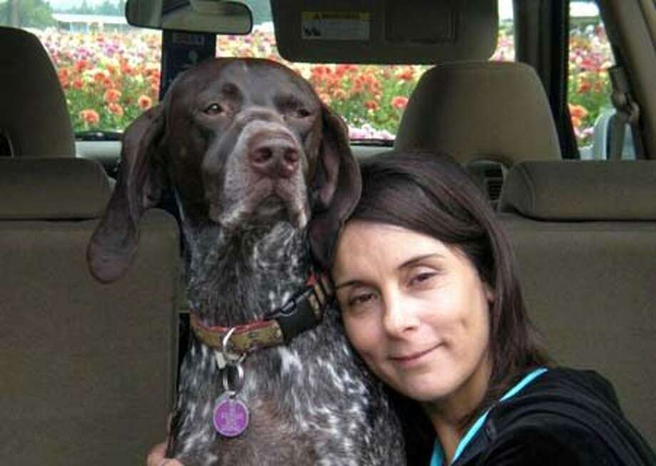 Lisa McKibbin poses with her dog, Sam, a 6-year-old German shorthair pointer, who died on Thanksgiving, Nov. 25, 2010, after being electrocuted by a Seattle City Light sidewalk plate.