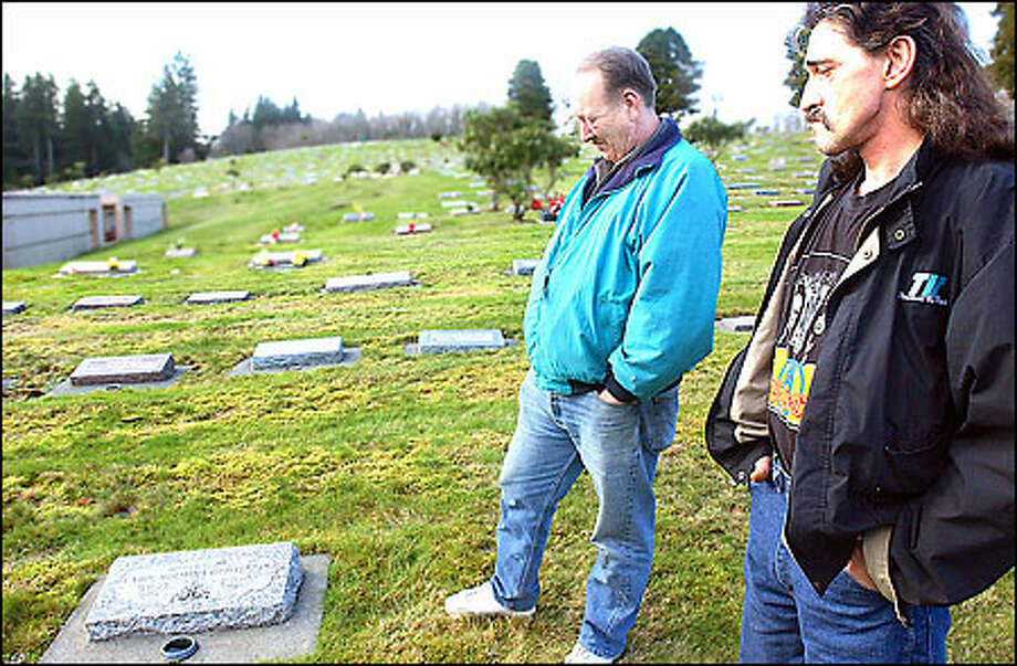 Don Holmin, right, brother of Green River Killer victim Carol Christensen, and her brother-in-law Bob Christensen visit her grave in Hoquiam. Photo: Associated Press / Associated Press