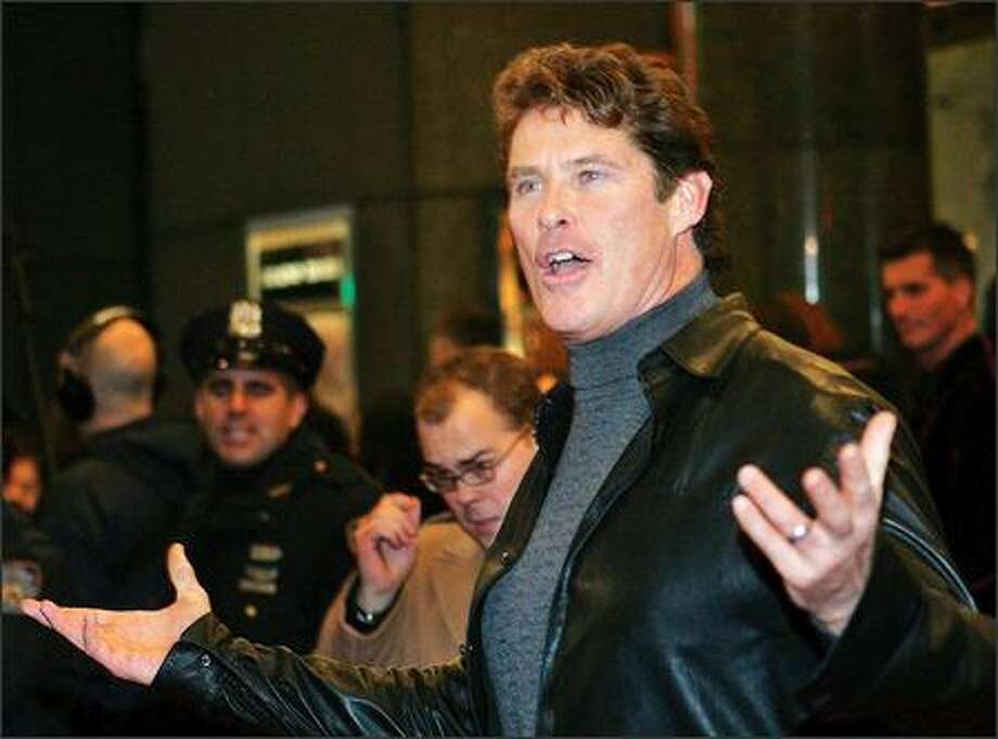 "There were many star-studded photos available from the Broadway premiere of ""The Color Purple"" on Thursday. There were shots of Oprah, Jamie Foxx, Naomi Campbell, Donald Trump, etc. But we chose to go with this photo of David Hasselhoff, primarily because we can't figure out what the heck he's doing there. Photo: Associated Press / Associated Press"