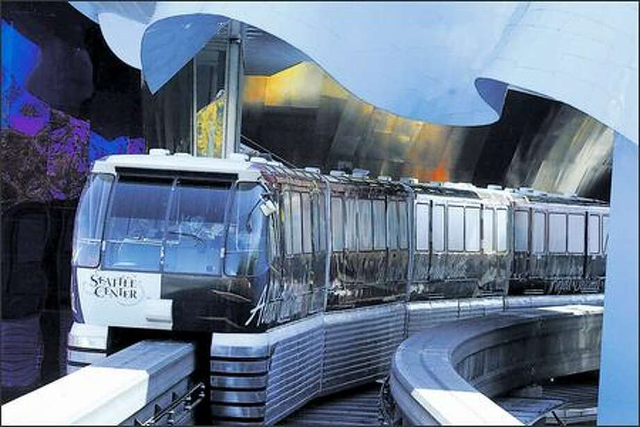 The Monorail heads through Experience Music Project on its short trip to Westlake Center. Critics who want to tear it down now that it's out of service may not realize that the Monorail is a moneymaker. Photo: Jim Bryant, Seattle Post-Intelligencer / Seattle Post-Intelligencer