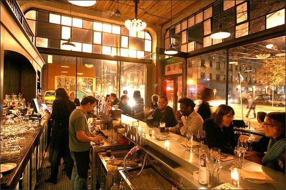 Quinn's massive space soars two stories; tables on the mezzanine level overlook the bar. Photo: Scott Eklund, Seattle Post-Intelligencer / Seattle Post-Intelligencer