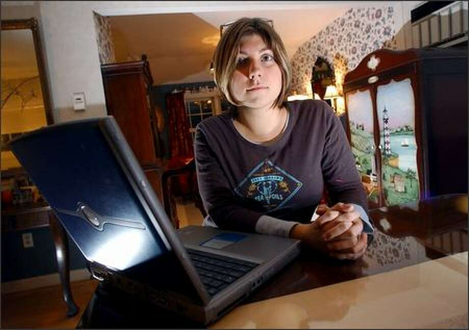 Sarah Kimmerle, 21, from Allentown, uses the Internet as a tool for study and research at her family home in Allentown. Kimmerle, a senior at Juniata College, holds some skepticism about the truth behind the information from the Internet. Photo: Associated Press / Associated Press