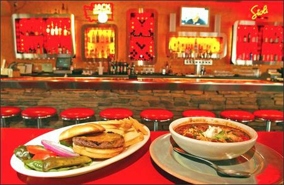 Both the grilled burger, left, and the beef and chorizo chili come highly recommended at the Cayenne Bar & Grill, in the Silver Cloud Hotel at the southern end of Capitol Hill. Photo: Gilbert W. Arias, Seattle Post-Intelligencer / Seattle Post-Intelligencer