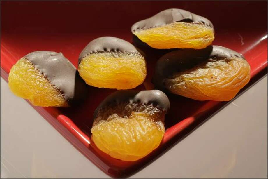 Chocolate-dipped dried apricots. Photo: Meryl Schenker, Seattle Post-Intelligencer / Seattle Post-Intelligencer