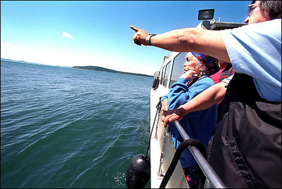 Samish elder Lena Daniels, 92, looks out at one of her family's traditional fishing spots off the north end of Orcas Island. Pointing toward Orcas is her son, Randy. Photo: Paul Joseph Brown, Seattle Post-Intelligencer / Seattle Post-Intelligencer