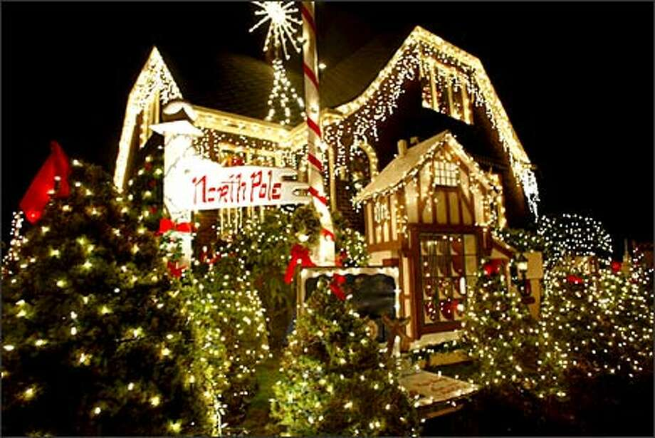A brightly lit North Pole display with yards of Christmas lights stands out at 7018 32nd Ave. N.W. Depending on the size of bulbs used, displays such as these can be pricey powerwise. Photo: Paul Kitagaki Jr., Seattle Post-Intelligencer / Seattle Post-Intelligencer