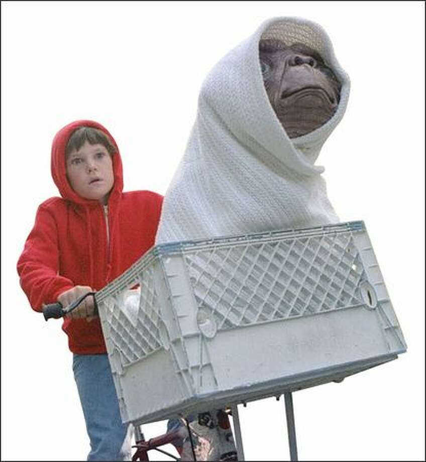 Henry Thomas and E.T. Photo: Universal Studios / Universal Studios