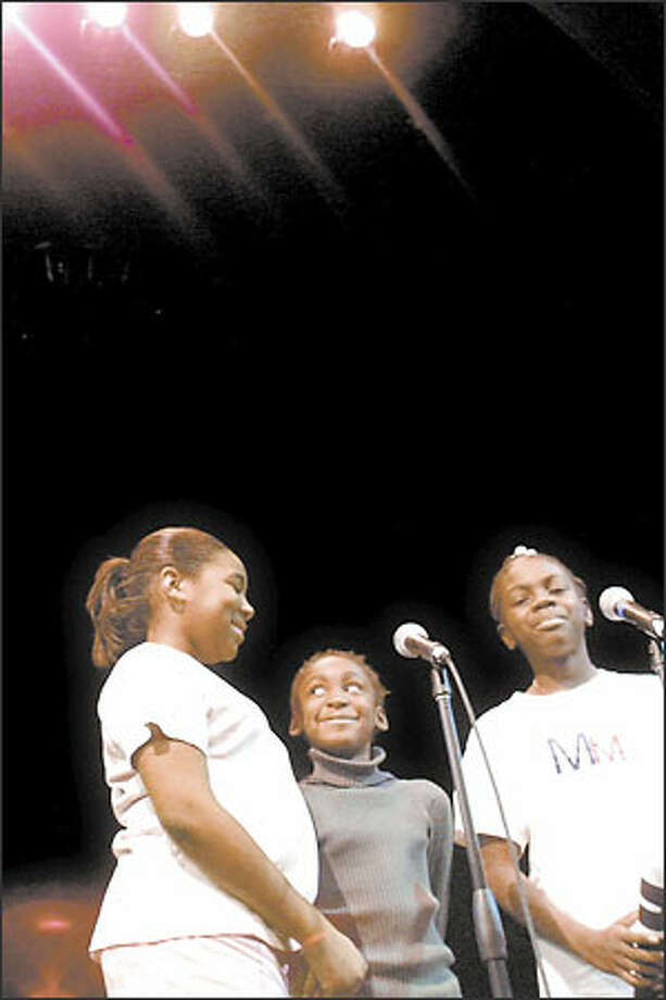 "Seattle siblings Porsche Lewis, 11; Akelia Lewis, 8, and Jasmin Lewis, 12, auditioned with the song, ""The World Needs Love."" Photo: Melina Mara, Seattle Post-Intelligencer / Seattle Post-Intelligencer"